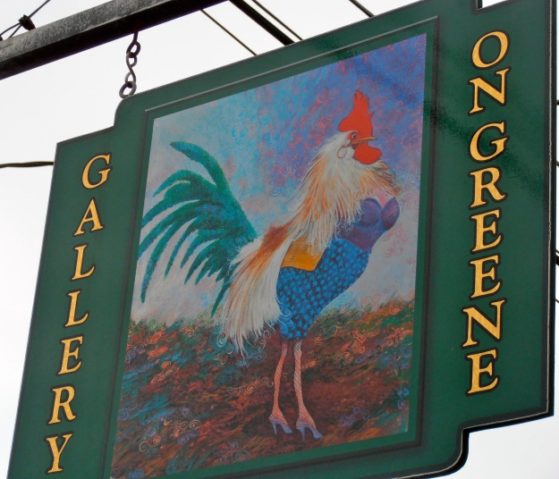 A fetching tranny rooster luring passers-by into a gallery