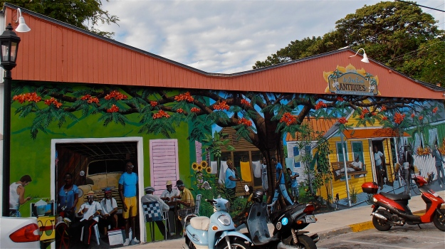 A painted wall in Bahama Village. None of the people are real ;-) I like how the scooters in front blend in with the mural.
