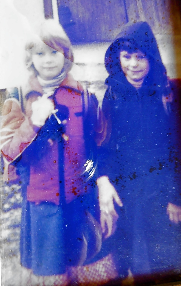 I took a shot of an already terribly grainy, faded picture, but it's the only one I have of Martina and I. We're probably eight years old, and it must have been taken after school, as we've both got school bags strapped to our backs.