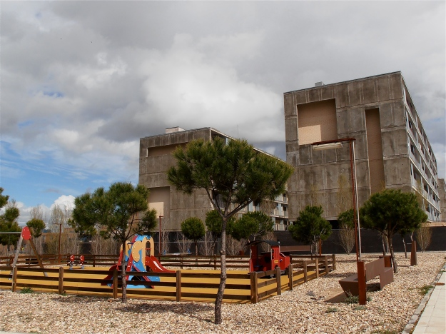 This playground doesn't see many children. The grey monoliths behind are not yet totally abandoned, although not totally abandoned, are in a sorry state of disrepair