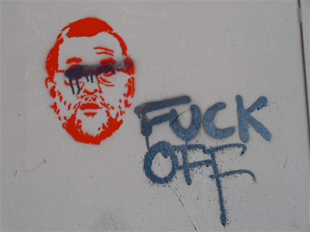 The stencil image is of Mariano Rajoy, Spain's current Prime Minister.