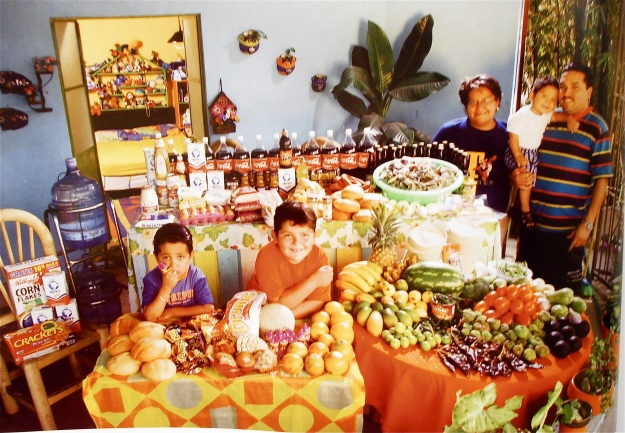 The Mexican family. Mexico has the highest per capita consumption of soft drinks after the US. And sure enough, the picture shows a whole row of Coke bottles in the back.