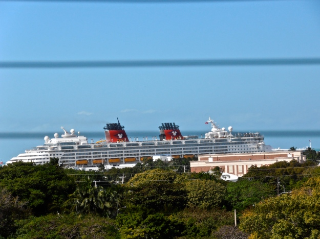 Zooming in through the window on one of those cruise ships. Looks like a toy!