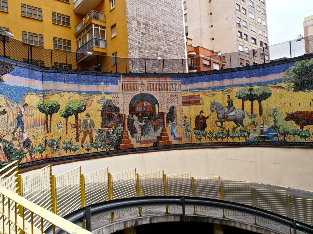 A mural above the entrance of an underground car park