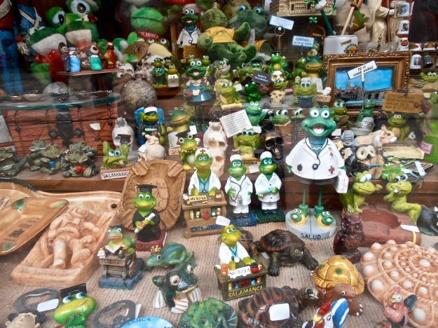 That frog has spawned copious offspring leaping about in hundreds of Salamancan shop windows.  This lot here seems to be keeping the astronaut good company :)