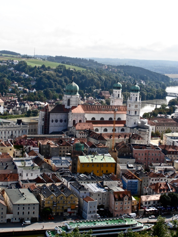 The building with the three domes is Passau Cathedral