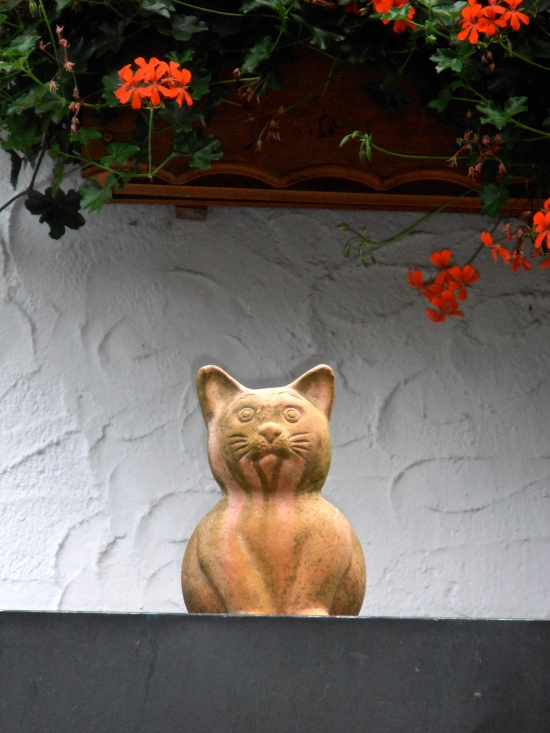 Terracotta kitty on a garage roof
