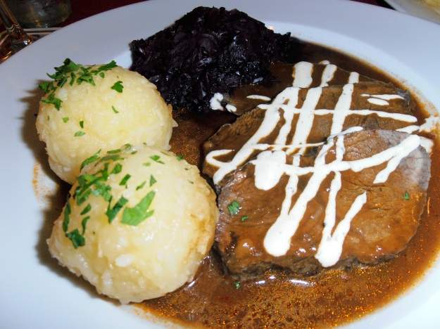 """""""Sauerbraten"""" - Beef (which has been marinated overnight), potato dumplings and red cabbage."""