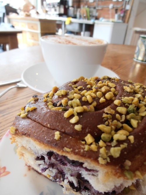 An adventurous Chelsea bun, with blueberries and pistachio topping, devoured in a new cafe in East Finchley. My friend had a delicious chocolate almond cake.