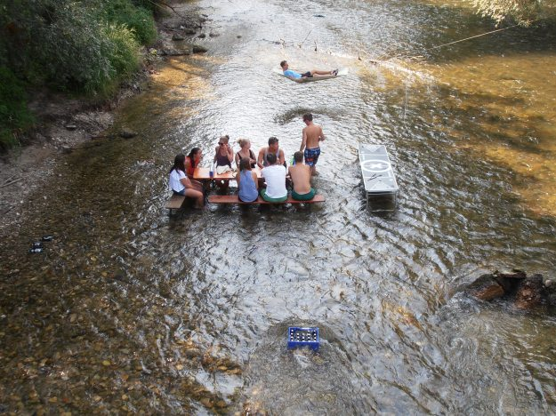 Why would you have a picnic by the river when you can actually be IN the river!?