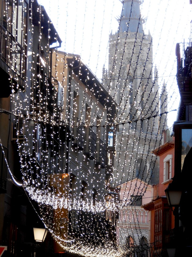 Taken on our walk between bars: The sun catching the Christmas lights, with Toledo cathedral in the background.