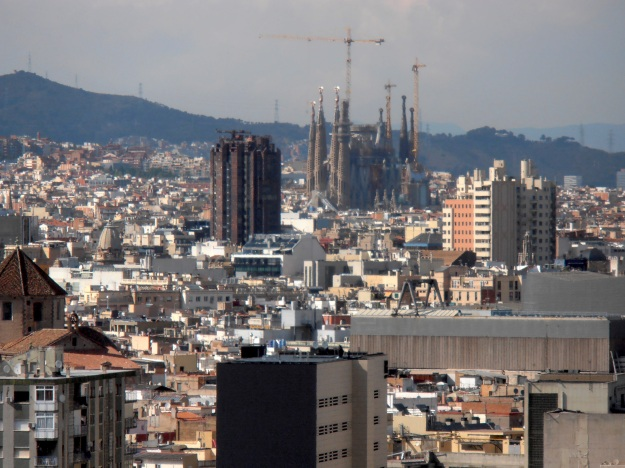 La Sagrada Familia in the distance - surrounded by construction machinery. It's due for completion in 2026. or 2028.